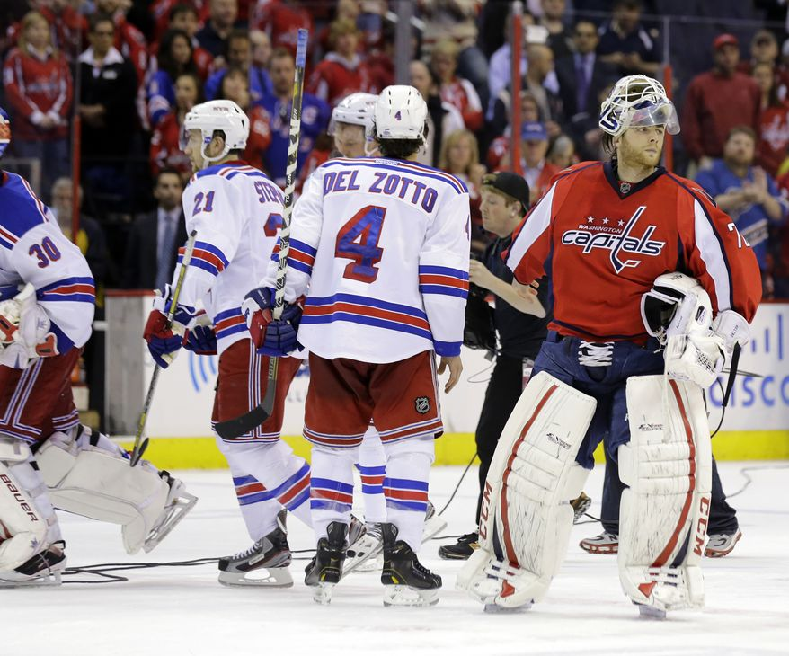 Washington Capitals goalie Braden Holtby (70) skates away after Game 7 first-round NHL Stanley Cup playoff hockey series, Monday against the New York Rangers, May 13, 2013 in Washington. The Rangers won 5-0. (AP Photo/Alex Brandon)