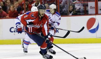 Washington Capitals center Mike Ribeiro (9) skates with the puck in the first period, of Game 7 first-round NHL Stanley Cup playoff hockey series against the New York Rangers, Monday, May 13, 2013 in Washington. (AP Photo/Alex Brandon)