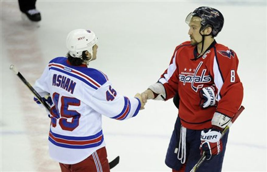 Washington Capitals left wing Alex Ovechkin (8), from Russia, shakes hands with New York Rangers right wing Arron Asham (45) after a Game 7 first-round NHL Stanley Cup playoff hockey series, Monday, May 13, 2013, in Washington. The Rangers won 5-0. (AP Photo/Nick Wass)