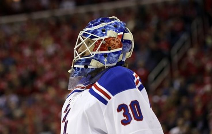 New York Rangers goalie Henrik Lundqvist (30), from Sweden, skates to the bench during a timeout, of Game 7 first-round NHL Stanley Cup playoff hockey series again