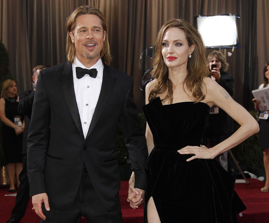 Actor Brad Pitt and actress Angelina Jolie arrive at the 84th Academy Awards in the Hollywood section of Los Angeles on Feb. 26, 2012. (AP Photo/Amy Sancetta)