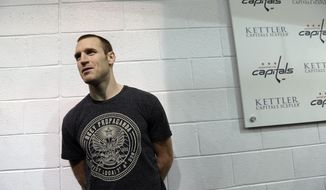 Washington Capitals' Brooks Laich waits to talk with reporters at the Kettler Iceplex in Arlington, Va., Wednesday, May 15, 2013. The Capitals were eliminated in the first round of the NHL Stanley Cup playoffs by the New York Rangers. The Capitals have had six consecutive playoff appearances and have failed to get past the second round. (AP Photo/Susan Walsh)