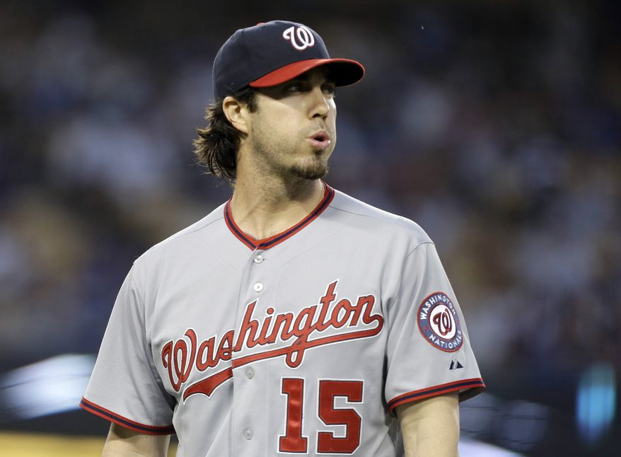 Dan Haren pitched seven strong innings for the Nationals on Tuesday night, but it wasn't enough as he was out-dueled by Dodgers ace Clayton Kershaw. (Associated Press photo)