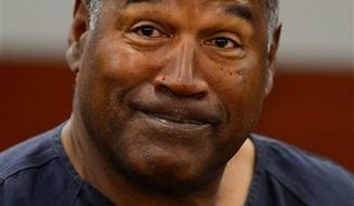 O. J. Simpson testifies Wednesday at a hearing aimed at proving Simpson's trial lawyer, Yale Galanter,  had conflicted interests and shouldn't have handled Simpson's case. The former football great, shown here on Tuesday in Clark County District Court, is serving nine to 33 years in prison for his 2008 conviction in the armed robbery of two sports memorabilia dealers in a Las Vegas hotel room. (AP Photo/Ethan Miller, Pool)