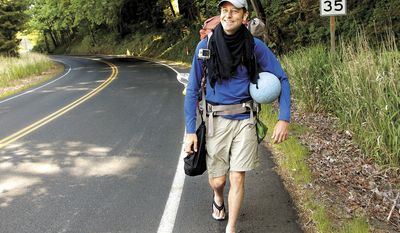 In this May 7, 2013, photo, Richard Swanson, of Seattle, walks along a road in Kelso, Wash. Swanson, who was trying to dribble a soccer ball to Brazil in time for the 2014 World Cup, died Tuesday, May 14, 2013, after being hit by a pickup truck on the Oregon Coast. (AP Photo/The Daily News, Bill Wagner)