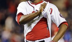 Washington Nationals relief pitcher Rafael Soriano (29) un-tucks his shirt after a baseball game against the Detroit Tigers at Nationals Park, Wednesday, May 8, 2013, in Washington. The Nationals won 3-1. (AP Photo/Alex Brandon)