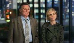 "Robin Williams (left) and Sarah Michelle Gellar appear in a scene from the pilot episode of ""The Crazy Ones,"" a CBS comedy premiering in the fall. (AP Photo/CBS, Richard Cartwright)"