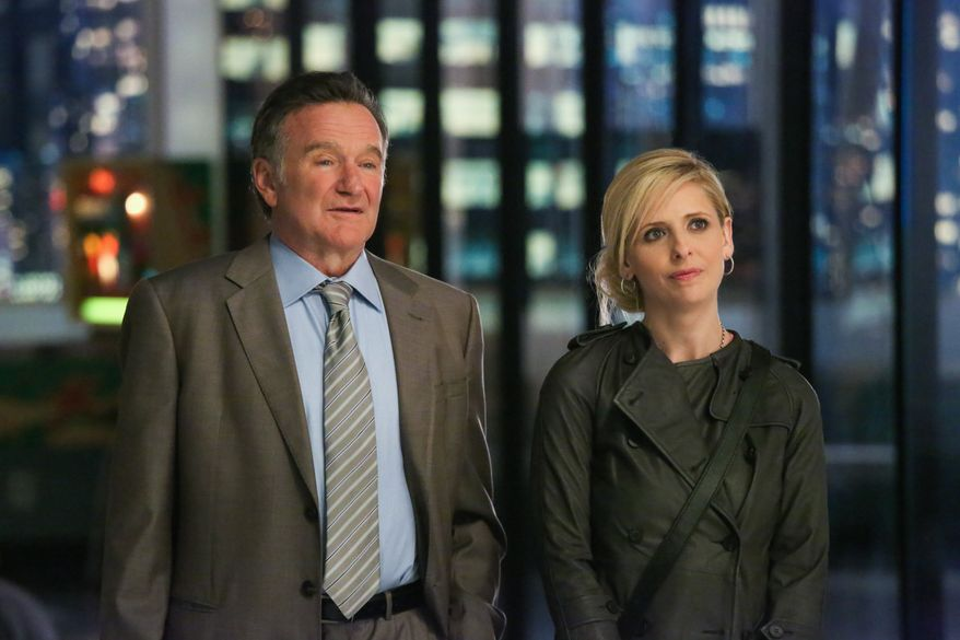 """Robin Williams (left) and Sarah Michelle Gellar appear in a scene from the pilot episode of """"The Crazy Ones,"""" a CBS comedy premiering in the fall. (AP Photo/CBS, Richard Cartwright)"""