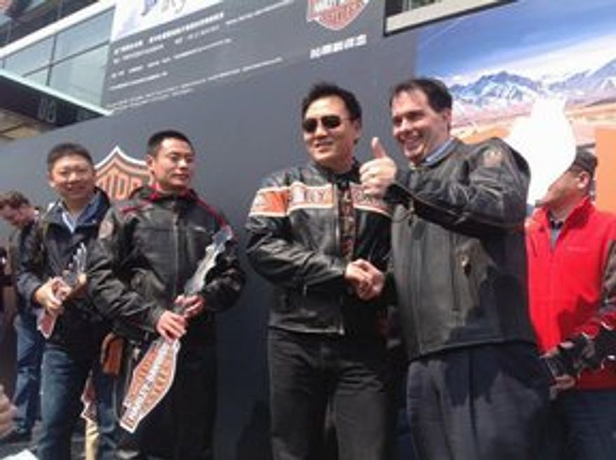 Clad in leather and flanked by fans of Harley-Davidson motorcycles, Wisconsin Gov. Scott Walker helps foster the love for the Milwaukee-based classic in China.