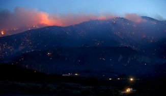 The Grand wildfire burns into the Los Padres National Forest near Gorman, Calif., where the blaze charred more than 3,000 acres on Wednesday, May 15, 2013. (AP Photo/Los Angeles Times, Luis Sinco)