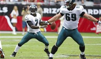 Philadelphia Eagles' Michael Vick (7) looks for an open receiver as Evan Mathis (69) protects the quarterback against the Arizona Cardinals during the second half in an NFL football game Sunday, Sept. 23, 2012, in Glendale, Ariz. The Cardinals defeated the Eagles 27-6.(AP Photo/Rick Scuteri)