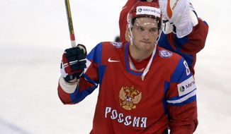 Russia's Alexander Ovechkin rasies his stick to the crowd after the 3-8 loss to USA at the 2013 Ice Hockey IIHF World Championships Group B Quarterfinal match Russia vs USA in Helsinki, Finland on Thursday May 16, 2013. (AP Photo/LEHTIKUVA / Martti Kainulainen)