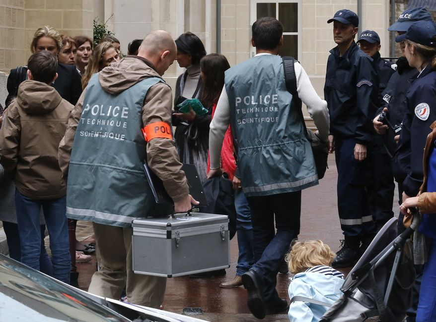 Police forensics officers arrive at the La Rochefoucauld school on Thursday, May 16, 2013, in Paris after a man committed suicide at the private Catholic institution by shooting himself in the head. (AP Photo/Jacques Brinon)