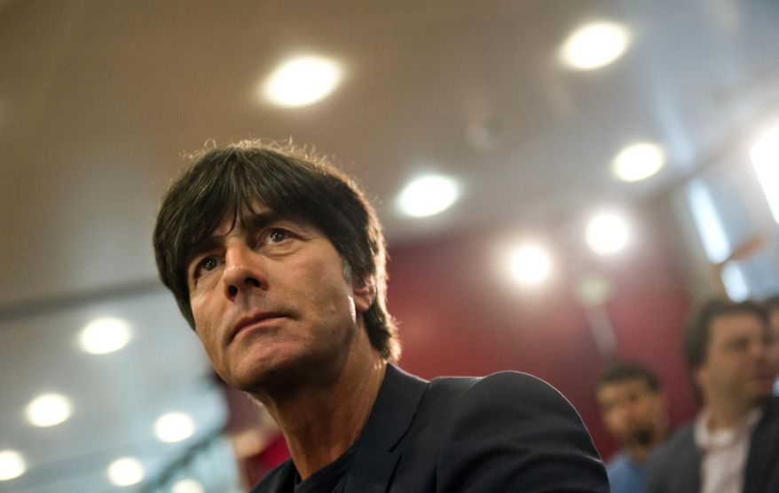 Germany's national soccer team head coach Joachim Loew attends a press conference in Frankfurt, Germany , Germany, Thursday May 16, 2013. Loew announced the line-up for the trip to the USA with the friendly matches against Ecuador in Boca Raton on May 29 and versus the US team in Washington June 2, 2013. (AP Photo/dpa, Nicolas Armer)