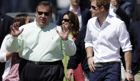 Britain's Prince Harry, right, walks with New Jersey Gov. Chris Christie at Casino Pier during a tour of the area hit by Superstorm Sandy, Tuesday, May 14, 2013, in Seaside Heights, N.J. The prince toured the community's rebuilt boardwalk, which is about two-thirds complete. New Jersey sustained about $37 billion worth of damage from the storm. (AP Photo/Julio Cortez)