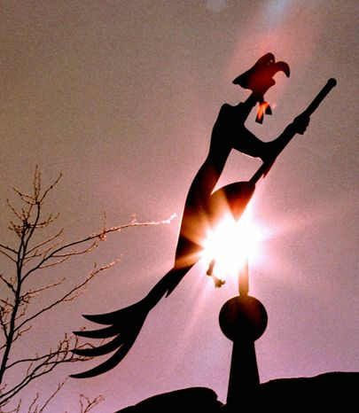 **FILE** A copper weather vane shaped like a witch on a broom sits atop a house in St. Georgen in the Black Forest region in southwestern Germany on January 21, 1997. (Associated Press)