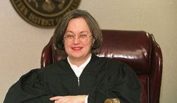 U.S District Judge Susan Webber Wright poses in a February 1998 handout photo in Little Rock, Ark. (Associated Press)