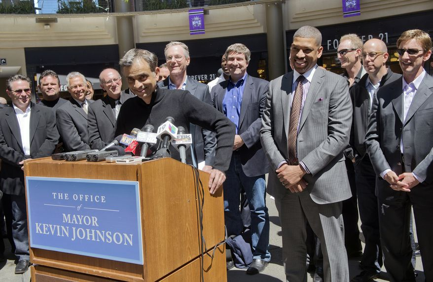 **FILE** TIBCO software chairman Vivek Ranadive, also a minority owner of the Golden State Warriors, speaks at a news conference with Sacramento Mayor Kevin Johnson, right, in Sacramento, Calif., on April 16, 2013. The potential Sacramento ownership group is headlined by Ranadive and 24 Hour Fitness founder Mark Mastrov. The Maloof family reached an agreement in January to sell a 65 percent controlling interest of the Kings to a Seattle group led by hedge-fund manager Chris Hansen at a total franchise valuation of $525 million, an NBA record, that would move the team to Seattle. (Associated Press/The Sacramento Bee)