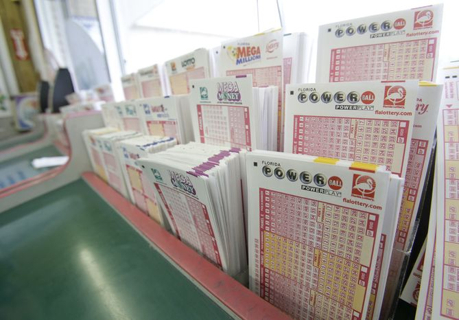 Powerball tickets, right, along with other lotto tickets are seen Thursday, May 16, 2013, at a convenience store in Orlando, Fla. The winning numbers will be drawn on Saturday. (AP Photo/John Raoux)