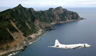 "The Japan Maritime Self-Defense Force patrols the Senkaku Islands, which China calls the Diaoyu Islands, in the East China Sea. China is trying to strengthen its claim on tiny, uninhabited, Japanese-controlled islands by raising questions about the much larger Okinawa chain that is home to more than 1 million Japanese along with major U.S. military installations. Tokyo has issued a ""stern protest."" (Associated Press)"