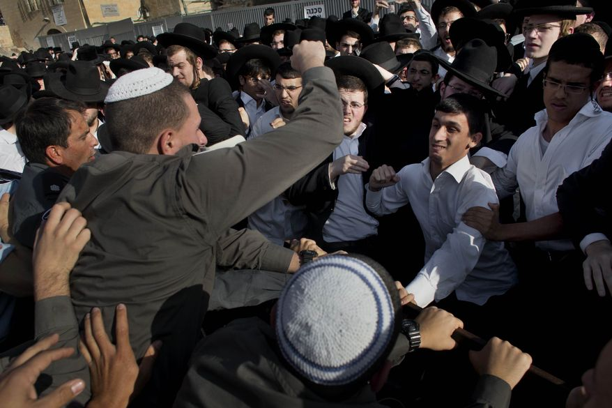 "** FILE ** Ultra-orthodox Jewish men scuffle with Israeli security forcers during a prayer organized by the ""Women of the Wall"" organization, not pictured, at the Western Wall, the holiest site where Jews can pray in Jerusalem's old city, Friday, May 10, 2013. (AP Photo/Bernat Armangue)"