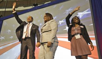 E.W. Jackson, with his wife Theodora (center) and daughter Jacquelyn (right), as he prepares to accept the GOP nomination for lieutenant governor of Virginia in Richmond in May, 2013. (AP Photo/Steve Helber)