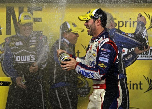 Jimmie Johnson celebrates with his crew in victory lane after winning the NASCAR All-Star auto race at Charlotte Motor Speedway in Concord, N.C., Saturday, May 18, 2013. (AP Photo/Nell Redmond)