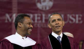 President Obama (right) and Morehouse College President John Silvanus Wilson Jr. stand onstage during the  college's 129th commencement exercises on Sunday, May 19, 2013, in Atlanta. (AP Photo/Carolyn Kaster)