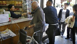 Customers line up to purchase Powerball lottery tickets on Saturday, May 18, 2013, in the Chinatown district in Oakland, Calif. (AP Photo/Ben Margot)