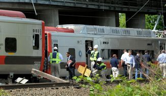 On Saturday, May 18, 2013, investigators from the National Transportation Safety Board and other officials investigate the scene of a train collision Friday evening near Bridgeport, Conn. Officials said it's fortunate that no one was killed and that there weren't even more injuries after two trains packed with rush-hour commuters collided. (AP Photo/The Connecticut Post, Cathy Zuraw)