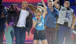 """Taylor Swift (center) performs at the Billboard Music Awards at the MGM Grand Garden Arena on Sunday, May 19, 2013, in Las Vegas. Miss Swift won eight of 11 awards, including top artist and top Billboard 200 album for """"Red."""" (Chris Pizzello/Invision/AP)"""