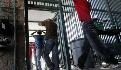 **FILE** Illegal immigrants prepare to enter a bus after being processed at the U.S. Border Patrol's Tucson Sector headquarters on Aug. 9, 2012, in Tucson, Ariz. (Associated Press)