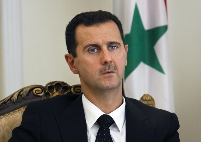 ** FILE ** This Wednesday, Aug. 19, 2009, file photo shows Syrian President Bashar Assad, seen, during a meeting with his Iranian counterpart Mahmoud Ahmadinejad, unseen, at the presidency in Tehran, Iran. (AP Photo/Vahid Salemi, Fil