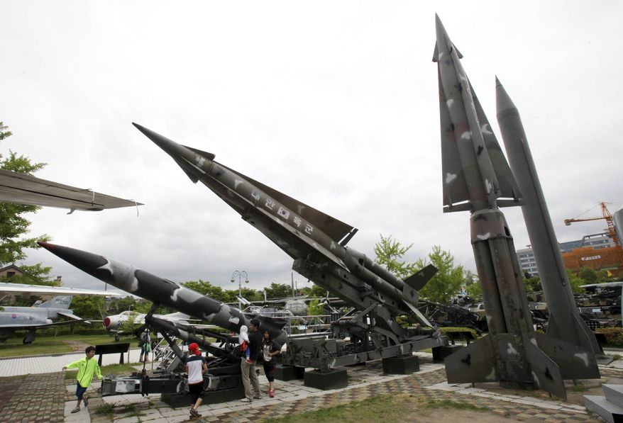 A mock Scud-B missile of North Korea, right, and other South Korean missiles are displayed at Korea War Memorial Museum in Seoul, South Korea, Sunday, May 19, 2013. (AP Photo/Ahn Young-joon)