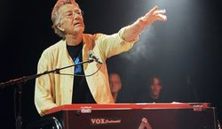 In this Aug. 16, 2012 file photo, Ray Manzarek performs at the Sunset Strip Music Festival launch party celebrating the Doors at the House of Blues in West Hollywood, Calif. Manzarek, the keyboardist who was a founding member of The Doors, has died at 74.(Photo by Chris Pizzello/Invision/AP, File)