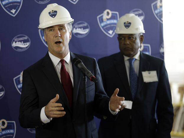 Washington Redskins general manager, Bruce Allen, left, speaks as Richmond Mayor Dwight Jones watches during a tour of the new Redskins training facility in Richmond, Va., Monday, May 20, 2013. (AP Photo/Steve Helber)
