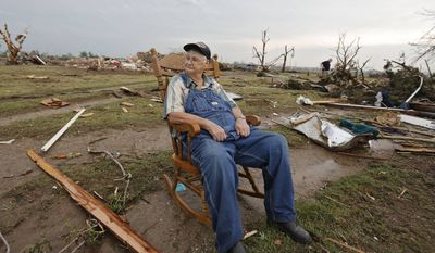 Gene Tripp sits in his rocking chair where his home once stood after being destroyed by a tornado hit the area near 149th and Drexel on Monday, May 20, 2013, in Oklahoma City, Okla. (AP Photo/ The Oklahoman, Chris Landsberger)