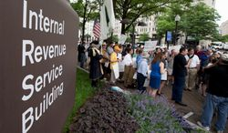 **FILE** Tea Party supporters gather for a rally outside the IRS headquarter in Washington on May 21, 2013. A few dozen tea party activists and their supporters have gathered outside the IRS headquarters in Washington to protest extra scrutiny of their organizations. (Associated Press)