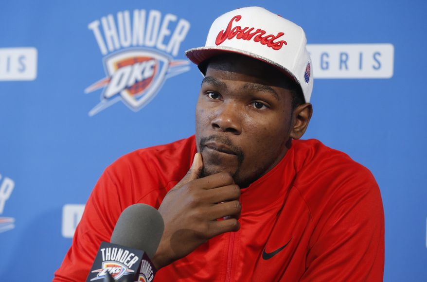 **FILE** Oklahoma City Thunder forward Kevin Durant listens to a question during an NBA basketball news conference in Oklahoma City, Thursday, May 16, 2013. Torpedoed by an injury to All-Star point guard Russell Westbrook, the Thunder's season is over far sooner than expected. After making it to the NBA Finals last season, Oklahoma City couldn't make it out of the second round this year with Westbrook sidelined.(AP Photo/Sue Ogrocki)