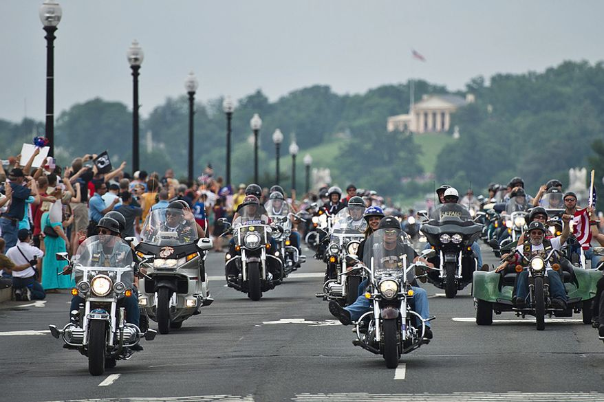 A trip across Arlington Memorial Bridge is part of the course for Ride for Freedom participants, whose mission in part is to bring awareness to the public about the POW/MIA issue. ** FILE **