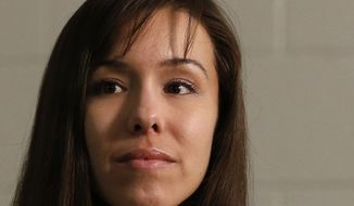 Convicted killer Jodi Arias thinks about a question asked during an interview at the Maricopa County Estrella Jail on Tuesday, May 21, 2013, in Phoenix. Arias was convicted of killing her former boyfriend, Travis Alexander, in his suburban Phoenix home in 2008 and could face the death penalty as the sentencing phase of her trial continues. (AP Photo/Ross D. Franklin)