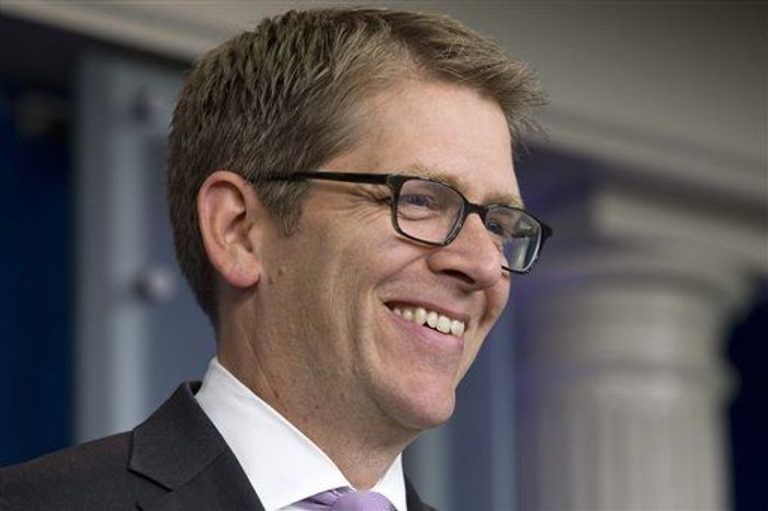 White House Press Secretary Jay Carney smiles after being wished a happy birthday by a reporter during his daily news briefing at the White House in Washington, Wednesday, May 22, 2013. At the briefing Carney announced that President Obama will travel to Oklahoma to visit tornado affected communities. (Associated Press)