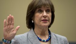 **FILE** IRS official Lois Lerner is sworn in on Capitol Hill in Washington on May 22, 2013, before the House Oversight Committee hearing to investigate the extra scrutiny IRS gave to tea party and other conservative groups that applied for tax-exempt status. Lerner told the committee she did nothing wrong and then invoked her constitutional right to not answer lawmakers' questions. (Associated Press)