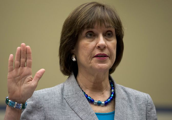 **FILE** IRS official Lois Lerner is sworn in on Capitol Hill in Washington on May 22, 2013, before the House Oversight Committee hearing to investigate the extra scrutiny IRS gave to tea party and other conservative groups that applied for tax-exempt status. Lerner told the committee she did nothing wrong and then invoked her const