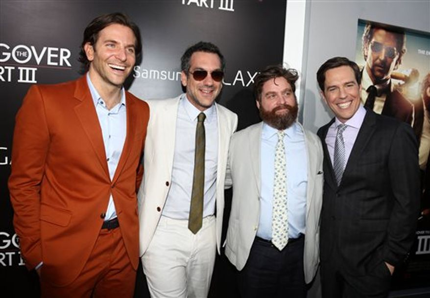 """From left, Bradley Cooper, director Todd Phillips, Zach Galifianakis and Ed Helms pose together at the Los Angeles premiere of """"The Hangover Part III."""" (Photo by Matt Sayles/Invision/AP)"""