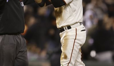 San Francisco Giants' Gregor Blanco celebrates after hitting a triple off of Washington Nationals pitcher Rafael Soriano to score Andres Torres during the ninth inning of a baseball game in San Francisco, Tuesday, May 21, 2013. (AP Photo/Jeff Chiu)