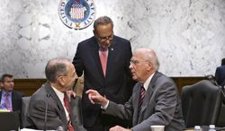 Senate Judiciary Committee Chairman Patrick Leahy, D-Vt., right, confers with Sen. Chuck Grassley, R-Iowa, left, the ranking member, as the Senate Judiciary Committee assembles to work on a landmark immigration bill to secure the border and offer citizenship to millions, on Capitol Hill in Washington, Monday, May 20, 2013. Sen. Chuck Schumer, D-N.Y., stands at center. (AP Photo/J. Scott Applewhite)
