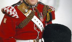 """This undated image released Thursday, May 23, 2013, by the British Ministry of Defence, shows Lee Rigby known as """"Riggers"""" to his friends, who is identified by the MOD as the serving member of the armed forces who was attacked and killed by two men in the Woolwich area of London on Wednesday. He was a drummer with the 2nd Battalion The Royal Regiment of Fusiliers."""" (AP Photo/MOD)"""