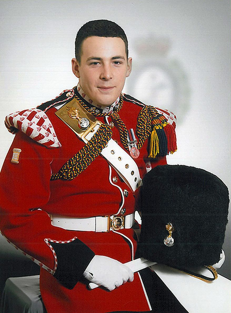 "This undated image released Thursday, May 23, 2013, by the British Ministry of Defence, shows Lee Rigby known as ""Riggers"" to his friends, who is identified by the MOD as the serving member of the armed forces who was attacked and killed by two men in the Woolwich area of London on Wednesday. He was a drummer with the 2nd Battalion The Royal Regiment of Fusiliers."" (AP Photo/MOD)"