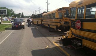 This image provided by the Kosciusko County Sheriff's Department shows a chain-reaction crash involving four buses in North Webster, Ind., Wednesday, May 22, 2013 The crash left dozens of middle and high school students with non-serious injuries and one driver seriously injured. (AP Photo/Kosciusko County Sheriff's Department)
